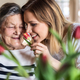 An elderly grandmother with an adult granddaughter at home, smelling flowers. - PhotoDune Item for Sale