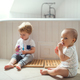 Two toddler children brushing teeth in the bathroom at home. - PhotoDune Item for Sale