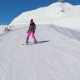 Beginner Skier Woman Carefully And Slowing Skiing Down On Ski Slope In Mountain - VideoHive Item for Sale