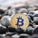 Coin Bitcoin Lies on the Beach. a Small Wave Covers Bitcoin. the Bitcoin Coin Lies on Beautiful Sea - VideoHive Item for Sale