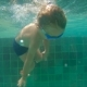 Shot of Little Boy Diving and Splashing in a Pool - VideoHive Item for Sale
