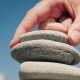 The Hand Puts the Stone in the Tower. Balance and Balance Concept - VideoHive Item for Sale