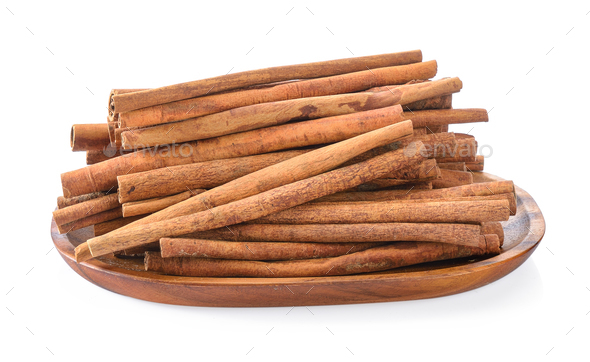 Cinnamon in basket on white background - Stock Photo - Images