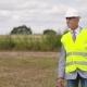 Energy Engineer Working on Digital Tablet Agains Windmills Farm - VideoHive Item for Sale