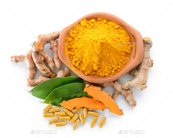 Turmeric powder and turmeric capsules on white background - Stock Photo - Images
