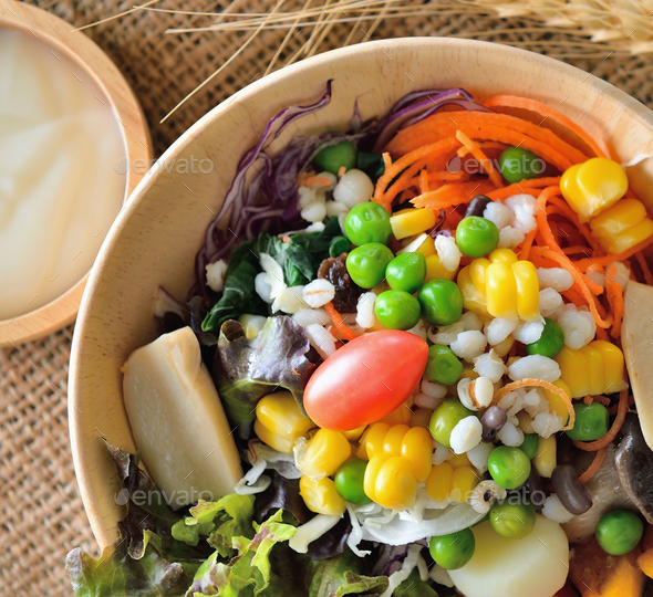 bowl of salad with vegetables  on wooden table - Stock Photo - Images