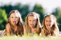 Three little girls sticking their tongues out - PhotoDune Item for Sale