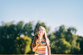 Little girl blowing soap bubbles in the park. - PhotoDune Item for Sale