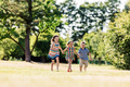 Three happy kids holding hands and running - PhotoDune Item for Sale