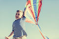 Little happy boy playing with a colorful kite - PhotoDune Item for Sale