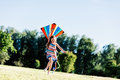 Happy little girl holding a kite and running - PhotoDune Item for Sale