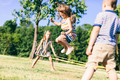 Little girl jumping high through the elastic. - PhotoDune Item for Sale