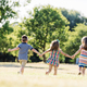 Three little children running on a green field - PhotoDune Item for Sale