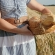 A Woman Is Carrying Bread in a Basket on a Wheat Field - VideoHive Item for Sale