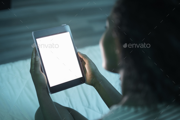 Woman Holding Tablet PC At Night Mockup Stock Photo by diego_cervo