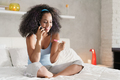 Happy Black Woman With Pregnancy Test Kit And Telephone - PhotoDune Item for Sale