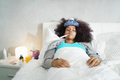 Woman With Fever Using Thermometer And Resting in Bed - PhotoDune Item for Sale