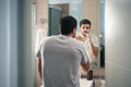 Hispanic Man Brushing Teeth In Bathroom At Morning - PhotoDune Item for Sale