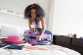African American Girl Preparing Baggage For Vacation And Travel - PhotoDune Item for Sale