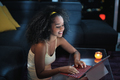 Young Latina Woman Typing Message on Laptop At Night - PhotoDune Item for Sale