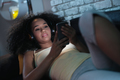 Black Woman Listening To Music On Phone At Night - PhotoDune Item for Sale