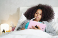 Girl With Fever Using Thermometer And Tablet In Bed - PhotoDune Item for Sale