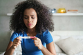 Sad Young Woman With Pregnancy Test At Home - PhotoDune Item for Sale