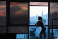 Young Woman Looking At Urban Landscape Out Of Window - PhotoDune Item for Sale