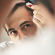 Young Man Applying Lotion For Alopecia And Hair Loss Treatment - PhotoDune Item for Sale