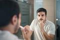 Hispanic Man Brushing Teeth In Bathroom At Morning - PhotoDune Item for Sale