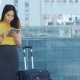 Asian Female Using Touchpad During Business Travel - VideoHive Item for Sale