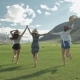 Group Of Friends Hold Hands And Run Away Toward Mountain - VideoHive Item for Sale