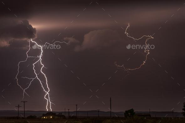 Large lightning strike at dusk on Tornado Alley - Stock Photo - Images
