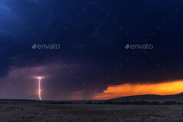 Large lightning strike at dusk on Tornado Alley - Stock Photo - Images