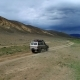 Aerial View of Safari Vehicle Driving on Sand Track Road in the Altay Mountain - VideoHive Item for Sale