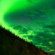 The Northern Lights Shine Up over a Mountainside near Valdez Alaska - PhotoDune Item for Sale