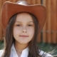 Portrait of the Young Girl Puts on Hat and Smiling at Camera. Slowly - VideoHive Item for Sale