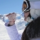 Woman Skier Drinking Clean Water From A Plastic Bottle On A Mountain Background - VideoHive Item for Sale