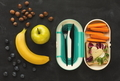 Lunch box with healthy food on black table background - PhotoDune Item for Sale