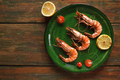 Shrimps with lemon on green plate - PhotoDune Item for Sale