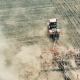 Aerial Drone Shot of a Farmer in Tractor Seeding - VideoHive Item for Sale
