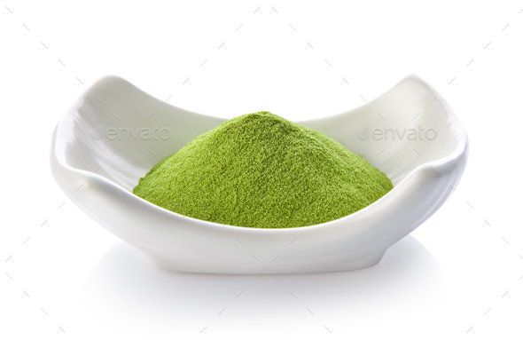 green tea powder in a bowl on white background - Stock Photo - Images