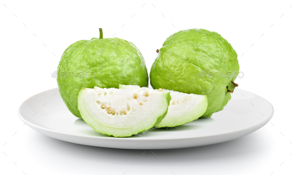 guava in a plate isolated on a white background - Stock Photo - Images