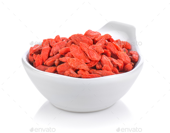 dried goji berries in a small white bowl - Stock Photo - Images