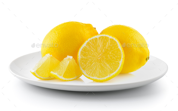 lemon in a plate isolated on a white background - Stock Photo - Images