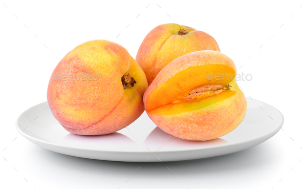 Peach in a plate isolated on a white background - Stock Photo - Images