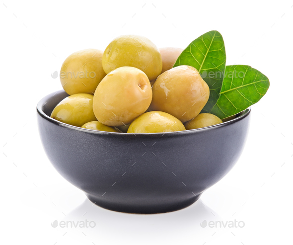green olives in a bowl on a white background - Stock Photo - Images