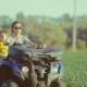 Teenage Girl Driving an ATV Off-road During Sunset - VideoHive Item for Sale