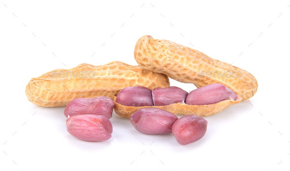 peanuts in closeup on white background - Stock Photo - Images