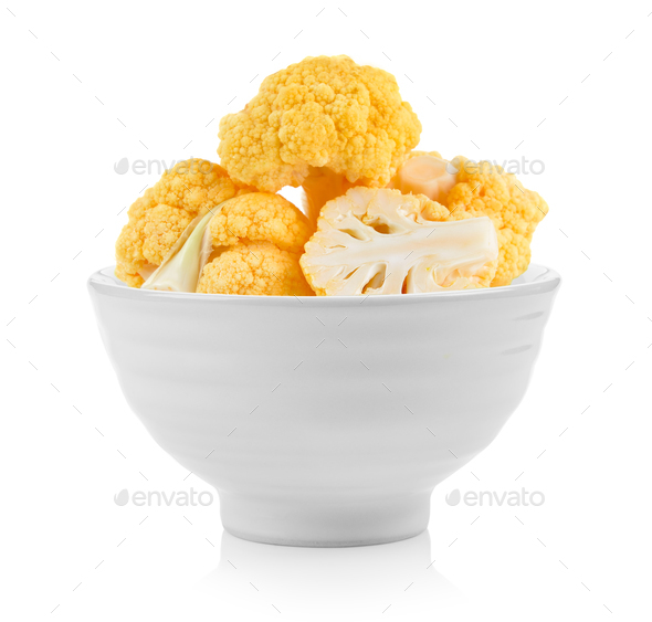 yellow cauliflower in a bowl on white background - Stock Photo - Images